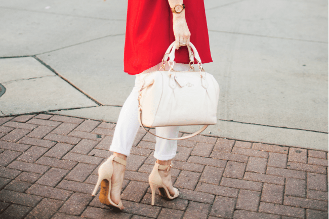 red-shirt-white-jeans-coach-bag