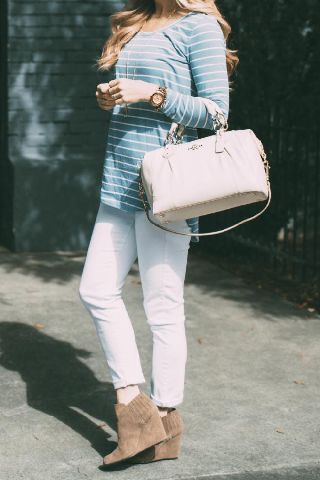 blue-striped-shirt-coach-handbag
